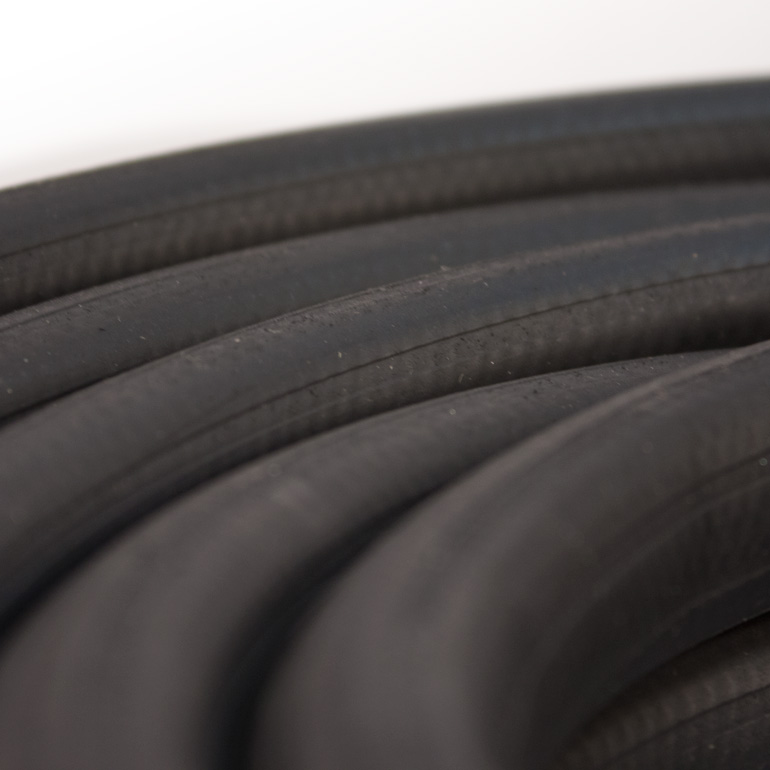 Black Rubber Garden Hose Close Up Image
